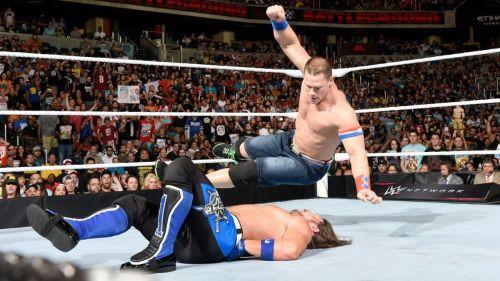 John Cena hits AJ Styles with the Five Knuckle Shuffle