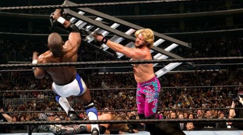 Chris Jericho smashes Shelton Benjamin with a ladder at Wrestlemania 21.