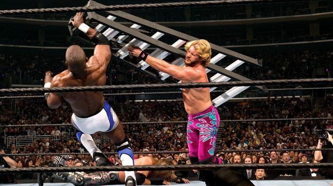 Chris Jericho smashes Shelton Benjamin with a ladder at Wrestlemania 21.