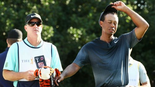 Tiger Woods, right, and caddie Joe LaCava