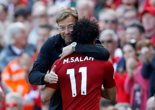 Enter captiJurgen Klopp was all smiles as Liverpool secured a Champions League spot on the final day of the seasonon