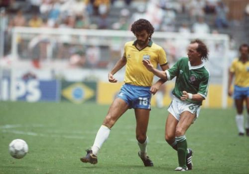 1986 World Cup Finals. Guadalajara, Mexico. 12th June, 1986. Brazil 3 v Northern Ireland 0. Brazil's Socrates is challenged for the ball by Northern Ireland's David McCreery.