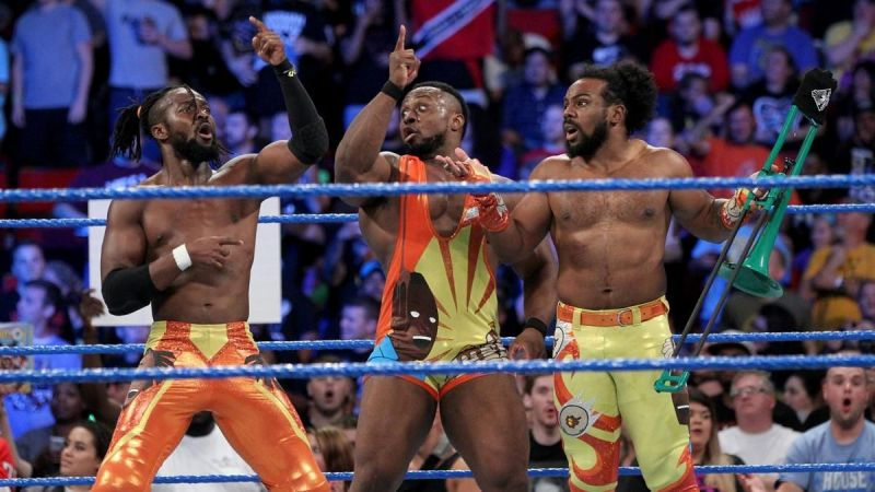The New Day celebrated after defeating the team of The Bar and The Miz