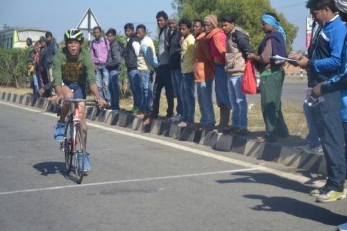People look on as Abhishek approaches the finish line during one his races