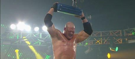 Kane holds the briefcase after his victory