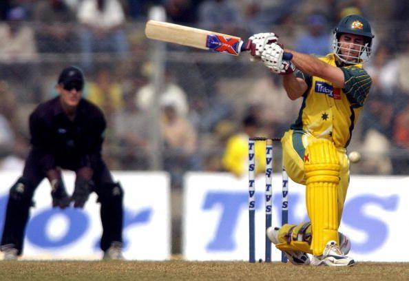 Australian batsman Michael Bevan (R) hit