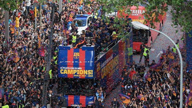 Barcelona parade: Iniesta signs off after securing a Copa del Rey and La Liga double