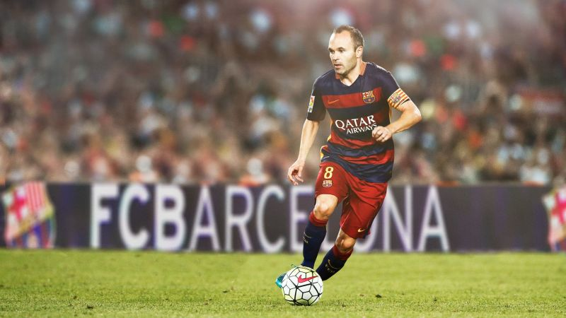 Andrés Iniesta is dyed in the blue and garnet colours of FC Barcelona