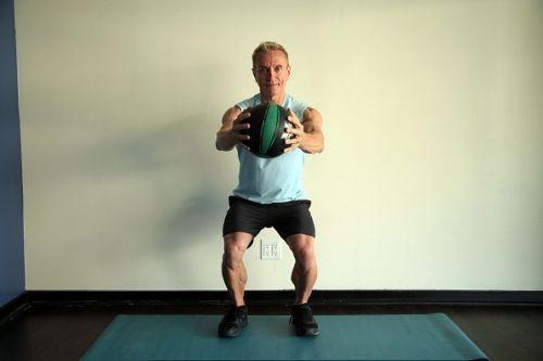 LONG BEACH, CA. 04/10/13 John Garey demonstrates 5 different exercises at his studio in Long Beach.