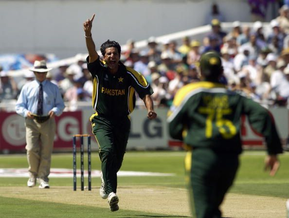 Wasim Akram of Pakistan celebrates the wicket of Marcus Trescothick of England