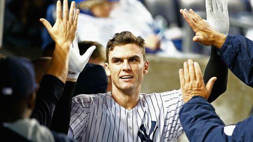 Greg Bird celebrates with his Yankees teammates