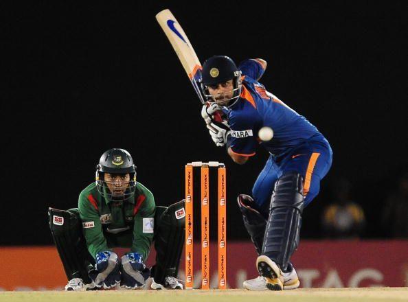 Indian cricketer Virat Kohli (R) is watc