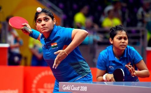 Mouma Das looks on as Madhurika Patkar plays a shot during the 2018 Commonwealth Games