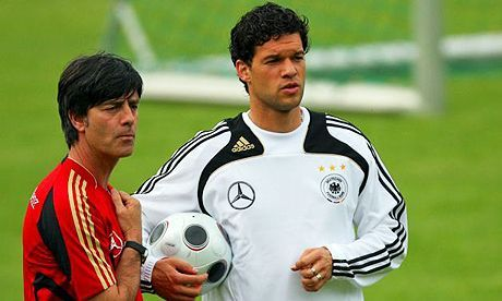 Low instructing Ballack in training session