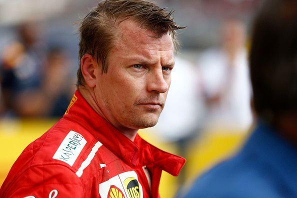 Kimi Raikkonen of  Finland  and  Scuderia Ferrari looks on...