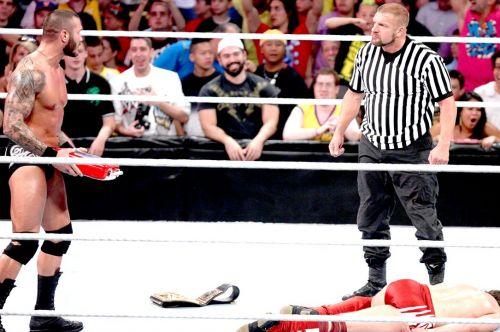 Triple H betrays Daniel Bryan and helps Randy Orton cash-in