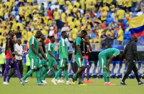 Dejected Senegal players after being knocked out of the World Cup