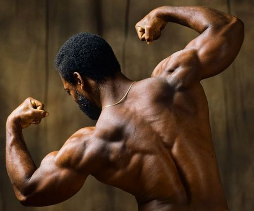 A bodybuilder displaying his strong back.