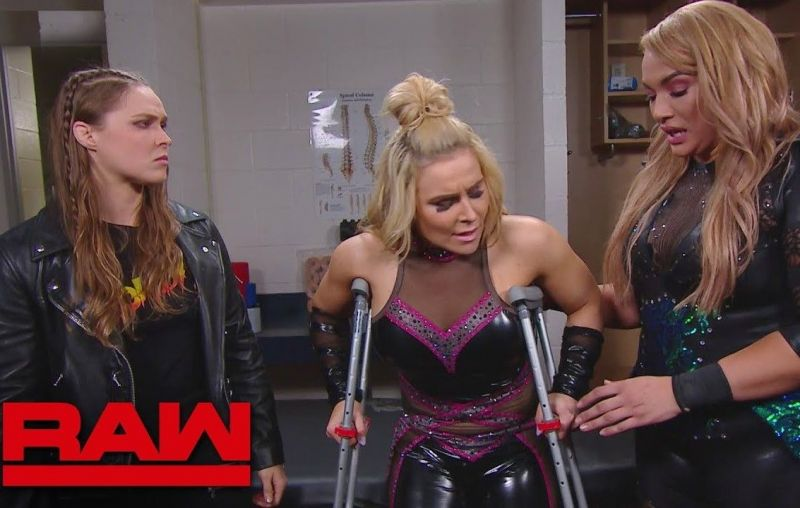 Ronda Rousey (Left) is close friends with Natalya (Center)