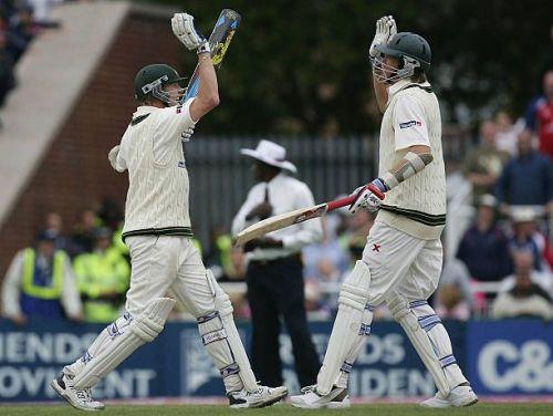 Brett Lee (L) and Glenn McGrath of Australia celebrate after holding on to draw