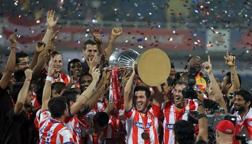 Atletico De Kolkata (now ATK) players celebrate with the trophy after their victory over Kerala Blasters in the final match of ISL 2014