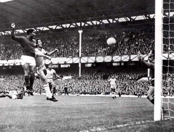 World Cup Finals, 1966. Liverpool, England. 19th July, 1966. Portugal 3 v Brazil 1. Eusebio of Portugal (L) beats Brazil