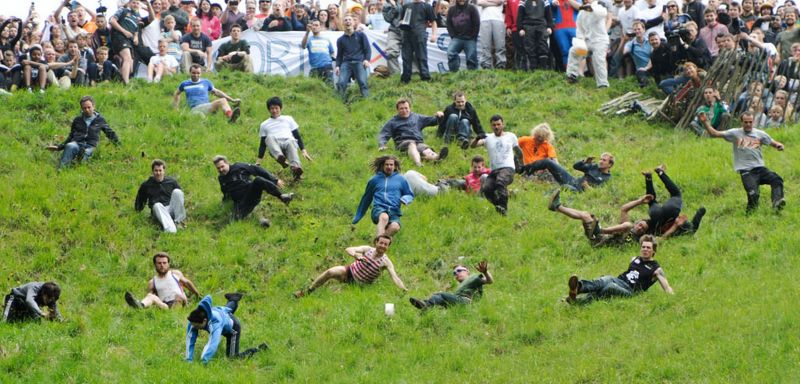 Cheese Rolling: Contestants rolls down a hill to catch the cheese. First person to cross the finish line is the winner.