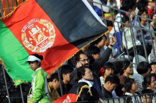 An Afghanistan cricket fan celebrates hi