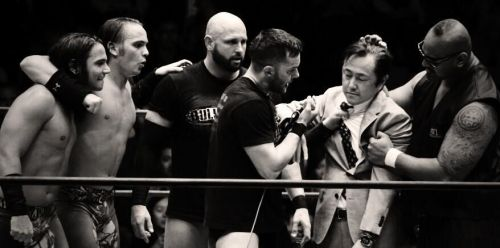 Devitt with the rest of The Bullet Club