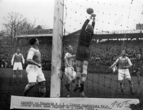 Soccer game Austria against Hungery (4:1). Zohrer ward off an attack. Austria, Vienna. Photograph around 1930.