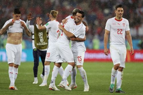Switzerland come from behind to clinch their first win of the tournament