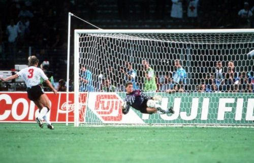 1990 World Cup Semi Final. Turin, Italy. 4th July, 1990. West Germany 1 v England 1 (West Germany win 4-3 on penalties). West Germany's goalkeeper Bodo Illgner dives to save Stuart Pearce's penalty kick in the shoot-out.