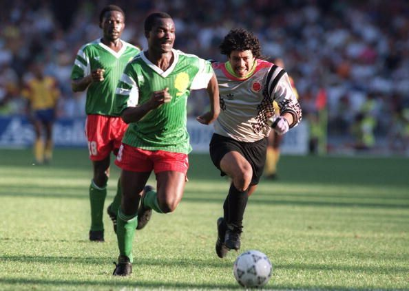 Forward Roger Milla from Cameroon runs past Colomb
