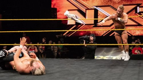 Tyler Bate throwing the towel for Moustache Moutain