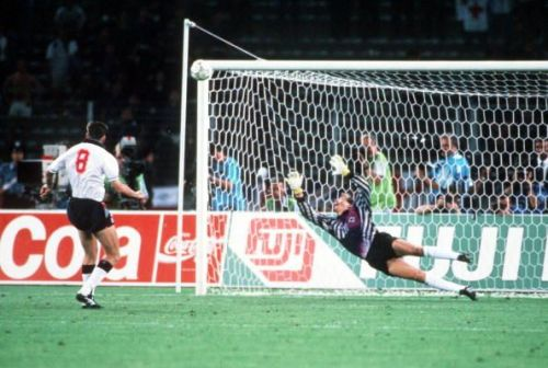 1990 World Cup Semi Final. Turin, Italy. 4th July, 1990. West Germany 1 v England 1 (West Germany win 4-3 on penalties). England's Chris Waddle fires his penalty over the bar past the dive of West German goalkeeper Bodo Illgner in the shoot -out. The pena