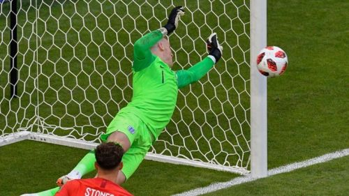 Jordan Pickford tips a Sweden effort around the post.
