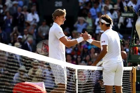 Kevin Anderson shakes hands with Roger Federer after an exhaustive encounter