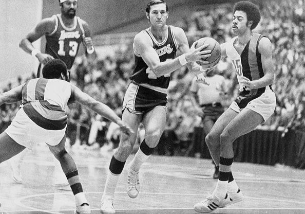 Jerry West (#44) and Wilt Chamberlain (#13)