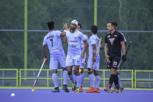 The Indian team celebrate after scoring a goal