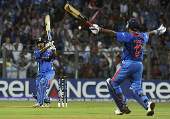 Indian captain Mahendra Singh Dhoni (L)