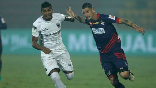 Nirmal Chhetri (left) vying for the ball in a match against ATK