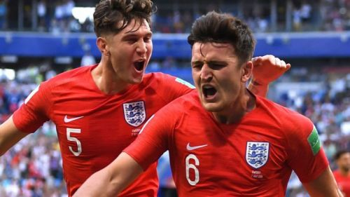 Harry Maguire and John Stones celebrate England's first goal.