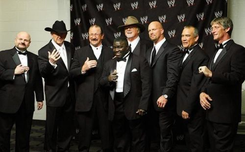 From left to right: Howard Finkel, Dory Funk Jr., Terry Funk, Koko B.Ware, 'Cowboy' Bill Watts, Steve Austin, Ricky Steamboat and Kevin Von Erich