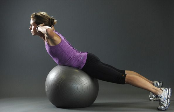Donna Miller a certified personal trainer and running coach shows core exercises to improve back stability on Thursday, December 2, 2010. This is the finishing point of back extensions on the Swiss ball. Fitness-ball back extension What it works: This bui