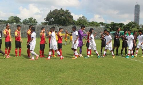 East Bengal and ATK players shake hands before their match