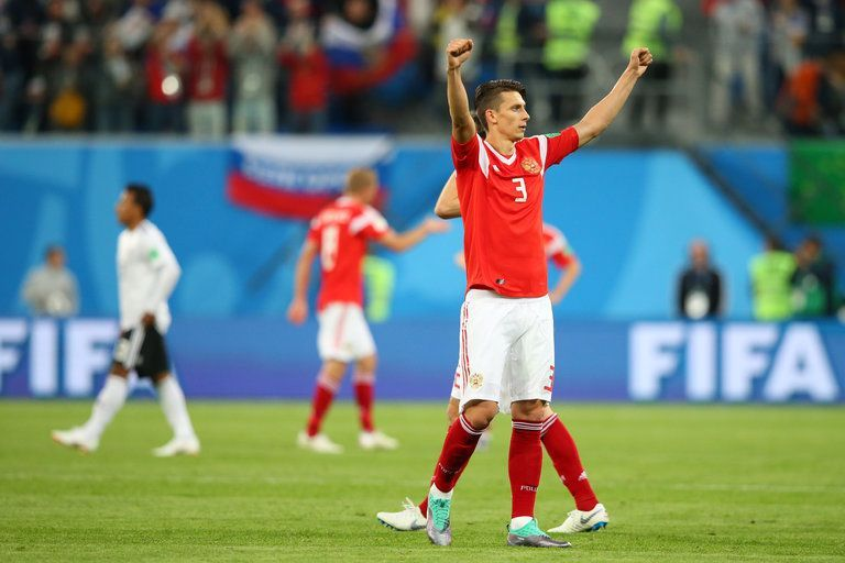Kupetov raises his arms celebrating a victory