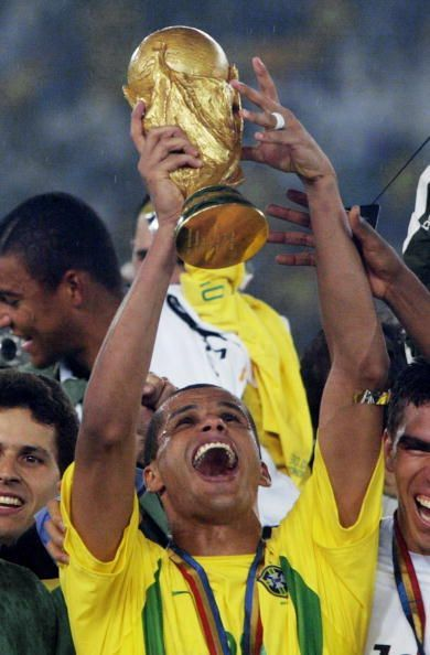 Brazil's midfielder Rivaldo hoists the World Cup t