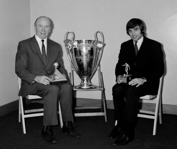 Football. 1968. Manchester United manager Matt Busby ( with his Manager of the Year Award) and star player George Best ( with his Footballer of the Year Award) sit with the European Cup trophy.