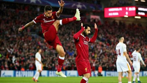 Roberto Firmino (l) and Mo Salah scored two goals apiece at Anfield