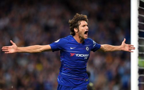 Marcos Alonso celebrates his winning goal against Arsenal